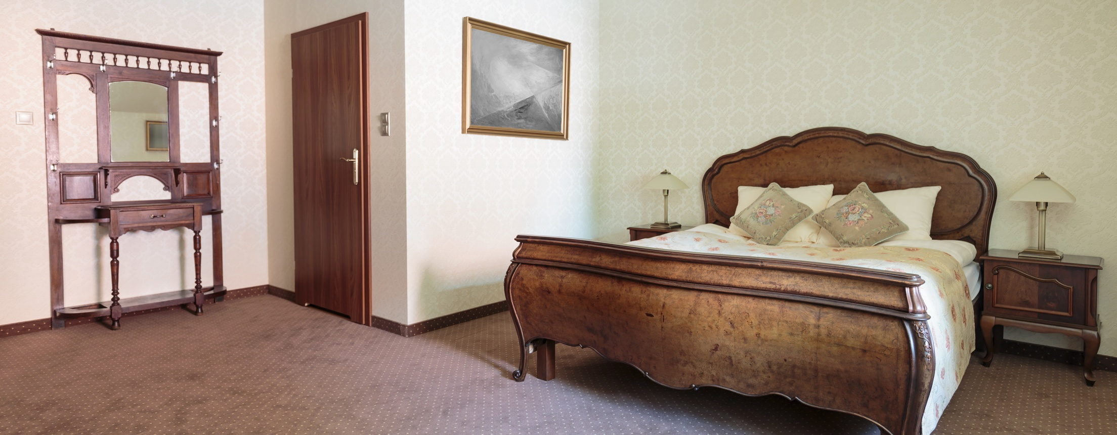 Antique style furniture in hotel double bed room